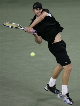 andy roddick two handed backhand chocked grip follow-through.jpg