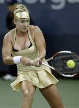 bethanie mattek two handed backhand at contact.jpg