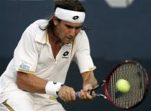 david ferrer two handed backhand at contact 3.jpg