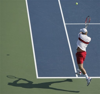 dmitry tursunov two handed backhand after contact down the line shot.jpg