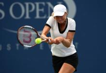 ekaterina makarova two handed backhand at contact.jpg