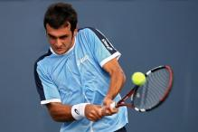 florent serra two handed backhand at contact.jpg
