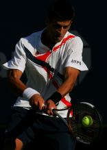 novak djokovic two handed backhand at contact 2.jpg