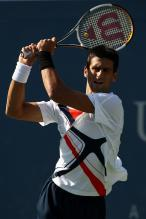 novak djokovic two handed backhand follow-through.jpg