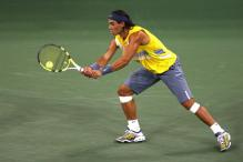 rafael nadal stretch two handed backhand at contact.jpg