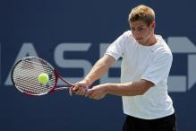 ryan thacher two handed forehand at contact.jpg