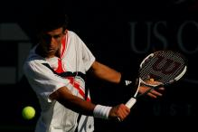 novak djokovic slice backhand near contact.jpg