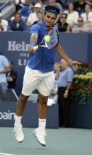 roger federer backhand at contact feet off the ground.jpg
