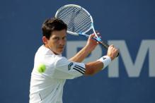 tim henman backhand slice before contact.jpg