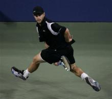 andy roddick between the leg shot follow through.jpg