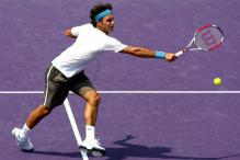 Roger Federer stretches for a backhand volley.jpg