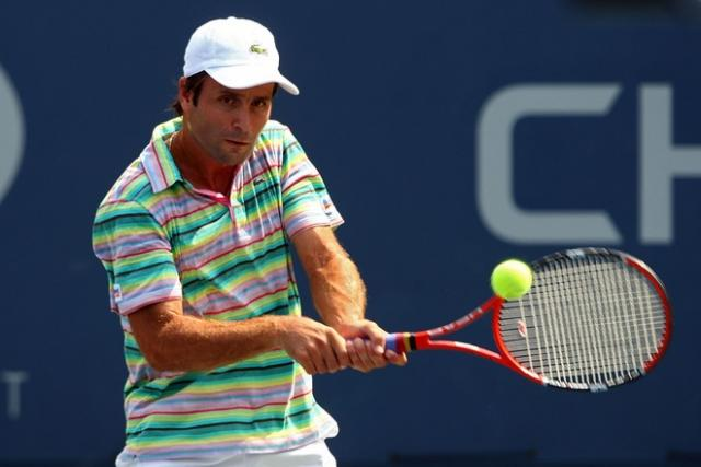 fabrice santoro two handed backhand at contact.jpg