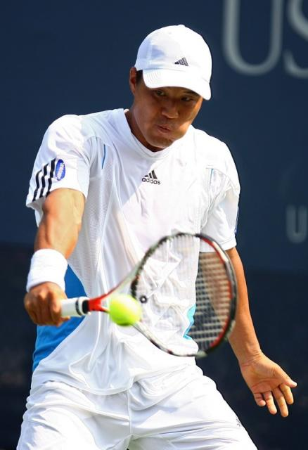hyung-taik lee one handed backhand at contact.jpg