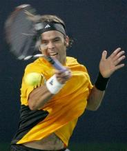 fernando gonzalez forehand right after contact.jpg