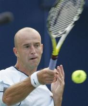 ivan ljubicic forehand right after contact.jpg