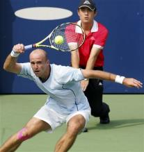 ivan ljubicic running forehand follow through.jpg