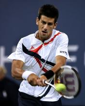 novak djokovic two handed backhand at contact.jpg