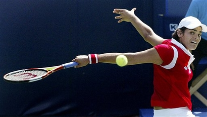 eleni daniilidou backhand slice follow through.jpg