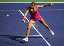 amelie mauresmo backhand volley before contact.jpg