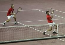 julian knowle defensive two handed volley at contact.jpg