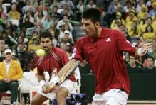 novak djokovic backhand volley near contact.jpg