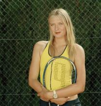 Maria Sharapova in yellow and black tennis outfit.jpg
