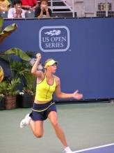 Maria Sharapova hit same-side forehand follow through.jpg
