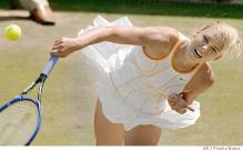 Maria Sharapova serves at Wimbledon 2005.jpg