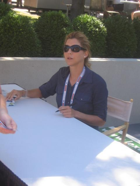 Monica Seles in sunglasses signs autographs.jpg