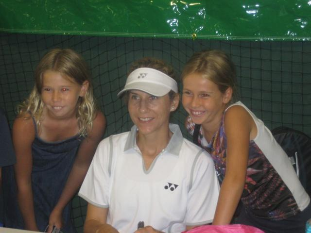 Monica Seles poses for a picture with two young fans.jpg