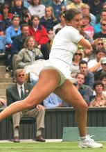 Monica Seles two handed forehand followthrough.jpg
