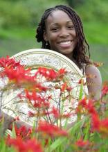 young Venus Williams with her trophy.jpg