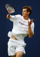Andy Murray hammers a forehand in a Fred Perry shirt.jpg