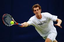 Andy Murray reaches for a defensive forehand shot.jpg