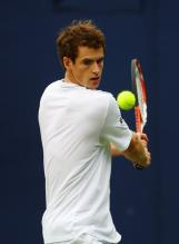 Andy Murray winds up for his two handed backhand.jpg