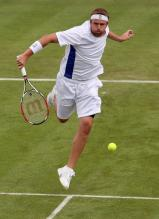 Mardy Fish hits a backhand volley approach shot.jpg
