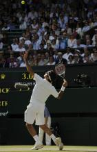 Roger Federer ball toss and serve at Wimbledon.jpg
