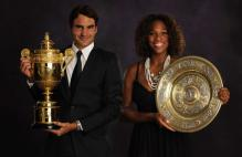 Roger Federer and Serena Williams hold their Wimbledon 2009 championship trophies.jpg