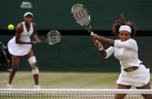 Serena Williams rips a backhand swinging volley during Wimbledon 2009.jpg
