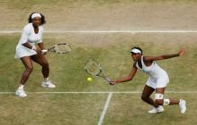 Venus Williams hits a forehand volley during the 2009 Women's Doubles Championship at Wimbledon.jpg