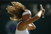 Victoria Azarenka forehand follow through with hair flowing.jpg