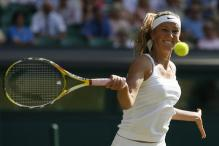 Victoria Azarenka goes for a vicious forehand.jpg