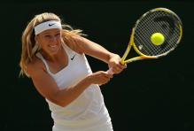 Victoria Azarenka hits a high forehand during Wimbledon 2009.jpg