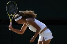 Victoria Azarenka looks to throw her racquet during her Wimbledon match 2009.jpg