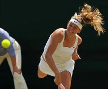 Victoria Azarenka serve follow through during Wimbledon 2009.jpg