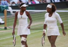 Venus Williams and Serena talk during their doubles match at Wimbledon 2009.jpg