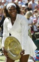 Serena Williams laughs holding her championship plate for Wimbledon 2009.jpg