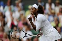 Serena Williams clenches a fist and celebrates a point.jpg