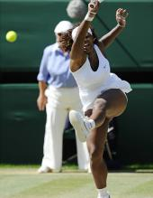 Serena Williams forehand follow through during Wimbledon 2009.jpg
