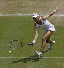 Elena Dementieva goes for the low forehand volley at Wimbledon.jpg